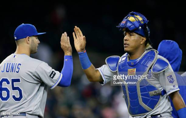 Winning pitcher Jake Junis of the Kansas City Royals highfives Salvador Perez after a 53 win over the Detroit Tigers in 12 inning at Comerica Park on...