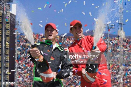 Winning race car drivers spraying champagne. : Bildbanksbilder