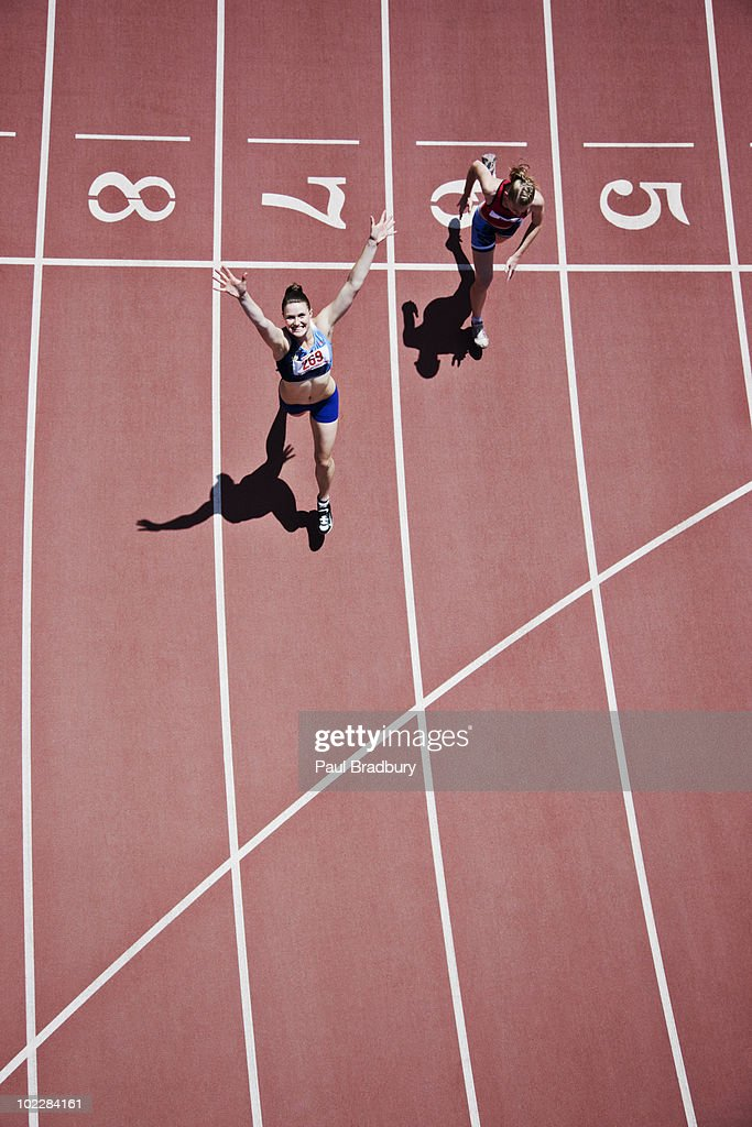Winning runner cheering on track : Stock Photo