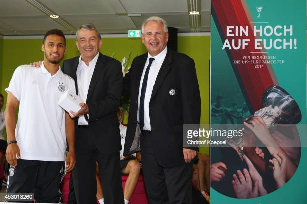 Winning scorer Hany Mukhtar gets a winning watch of Wolfgang Niersbach president of the DFB and vicepresident HansDieter Drewitz of the DFB during...