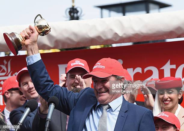 Winning trainer Darren Weir poses with the trophy after Prince of Penzance won race 7 the Emirates Melbourne Cup on Melbourne Cup Day at Flemington...