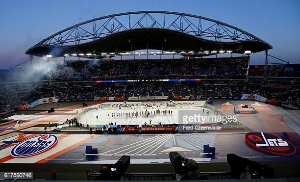 Winnipeg Jets and Edmonton Oilers shake hands at the end of the 2016 Tim Hortons NHL Heritage Classic hockey game on October 23 2016 at Investors...