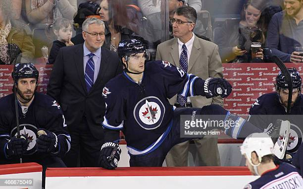 Winnipeg Jets' assistant coach Perry Pearn and head coach Claude Noel stand at the bench behind players Chris Thorburn Michael Frolik and Eric...
