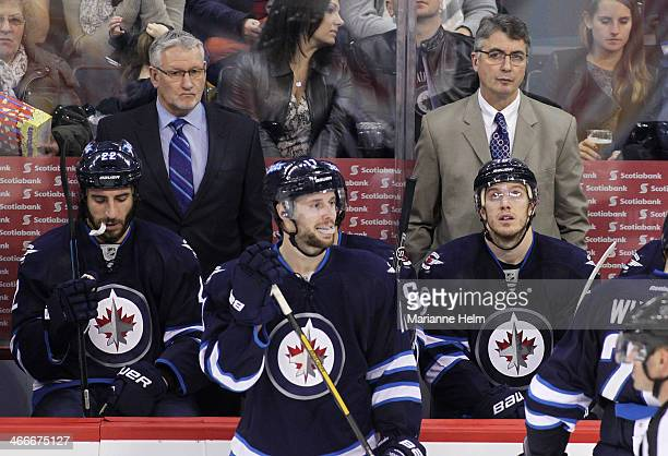 Winnipeg Jets' assistant coach Perry Pearn and head coach Claude Noel watch from the bench behind players Chris Thorburn James Wright and Bryan...