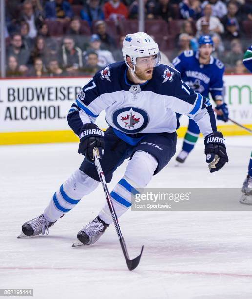 Winnipeg Jets Center Adam Lowry against the Vancouver Canucks in a NHL hockey game on October 12 at Rogers Arena in Vancouver BC