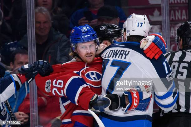Winnipeg Jets center Adam Lowry and Montreal Canadiens defenseman Jeff Petry are holding each other after the play during the second period of the...
