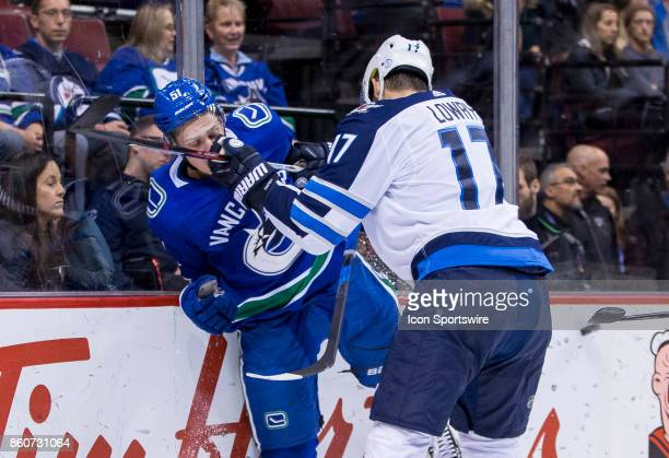 Winnipeg Jets Center Adam Lowry checks Vancouver Canucks Defenceman Troy Stecher in a NHL hockey game on October 12 at Rogers Arena in Vancouver BC