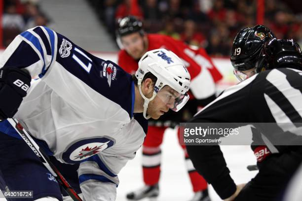 Winnipeg Jets Center Adam Lowry lines up for the face off during the second period in game between the Winnipeg Jets and Ottawa Senators on February...