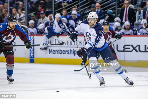 Winnipeg Jets Center Adam Lowry makes a pass during the Winnipeg Jets and Colorado Avalanche NHL game on February 4 at Pepsi Center in Denver CO