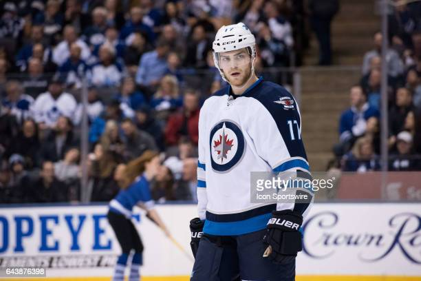 Winnipeg Jets Center Adam Lowry reacts during the third period of the NHL regular season game between the Toronto Maple Leafs and the Winnipeg Jets...