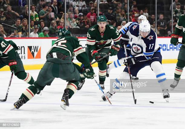 Winnipeg Jets center Adam Lowry rushes the puck up ice during a preseason NHL game between the Minnesota Wild and Winnipeg Jets on September 21 2017...