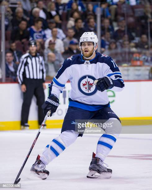 Winnipeg Jets Center Adam Lowry skates against the Vancouver Canucks in a NHL hockey game on October 12 at Rogers Arena in Vancouver BC