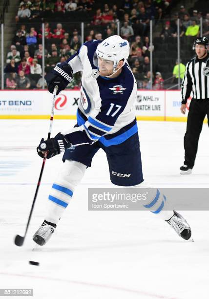 Winnipeg Jets center Adam Lowry takes a shot during a preseason NHL game between the Minnesota Wild and Winnipeg Jets on September 21 2017 at Xcel...