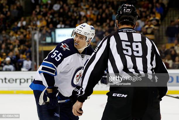 Winnipeg Jets center Mark Scheifele checks with the point prior to a face off during a regular season NHL game between the Boston Bruins and the...
