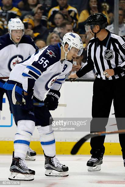 Winnipeg Jets center Mark Scheifele gets set for a face off during a regular season NHL game between the Boston Bruins and the Winnipeg Jets on...