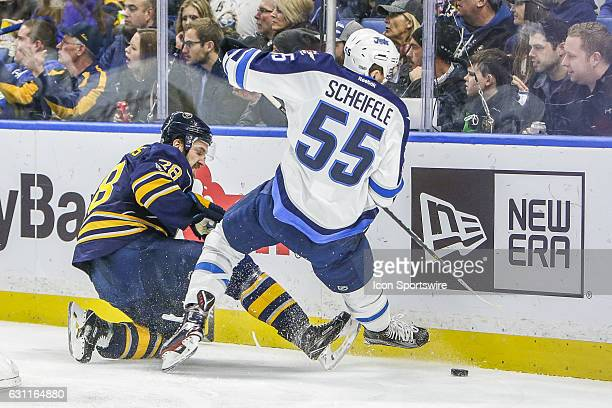 Winnipeg Jets Center Mark Scheifele loses his footing as Buffalo Sabres Winger Zemgus Girgensons defends during the New Winnipeg Jets and Buffalo...