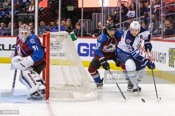 Winnipeg Jets Center Mark Scheifele skates with puck as Colorado Avalanche Defenseman Mark Barberio defends during the Winnipeg Jets and Colorado...