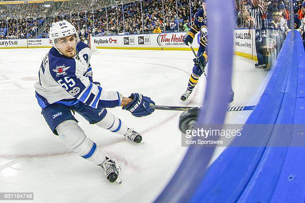 Winnipeg Jets Center Mark Scheifele tracks puck near photo hole during the New Winnipeg Jets and Buffalo Sabres NHL game on January 7 at KeyBank...