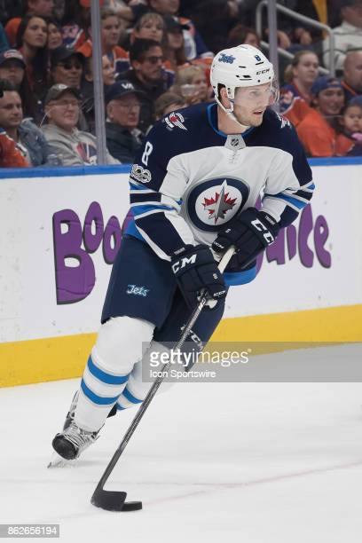 Winnipeg Jets Defenceman Jacob Trouba carries the puck up the ice during the Edmonton Oilers game versus the Winnipeg Jets at Rogers Place in...