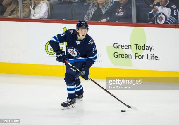 Winnipeg Jets defenseman Sami Niku skates with the puck during the NHL game between the Winnipeg Jets and the Edmonton Oilers on September 20 2017 at...