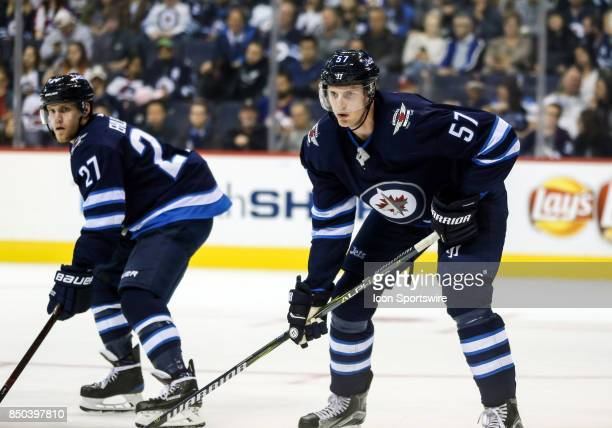 Winnipeg Jets defenseman Tyler Myers awaits the faceoff during the NHL game between the Winnipeg Jets and the Edmonton Oilers on September 20 2017 at...