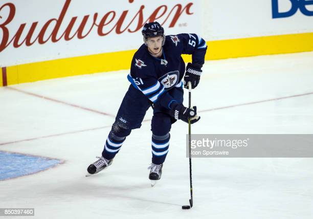Winnipeg Jets defenseman Tyler Myers skates with the puck during the NHL game between the Winnipeg Jets and the Edmonton Oilers on September 20 2017...