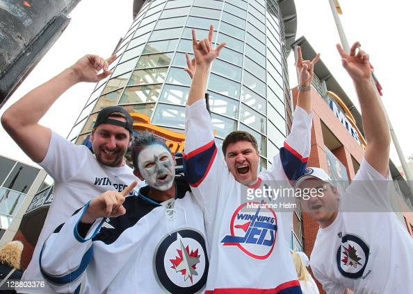 Winnipeg Jets fans Andrew Sinclair Eric Hogue Kyle MacKay and Tyler Contant make their way to the MTS Centre before the Winnipeg Jets game against...