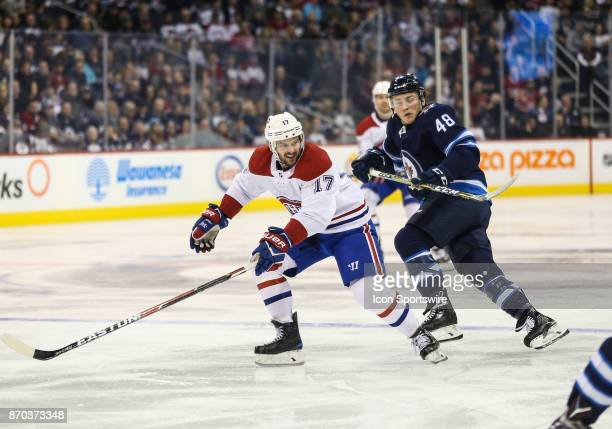 Winnipeg Jets forward Brendan Lemieux and Canadiens forward Torrey Mitchell look for the puck during the NHL game between the Winnipeg Jets and the...