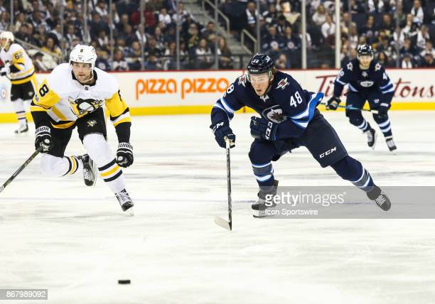 Winnipeg Jets forward Brendan Lemieux chases the puck during the NHL game between the Winnipeg Jets and the Pittsburgh Penguins on October 29 2017 at...