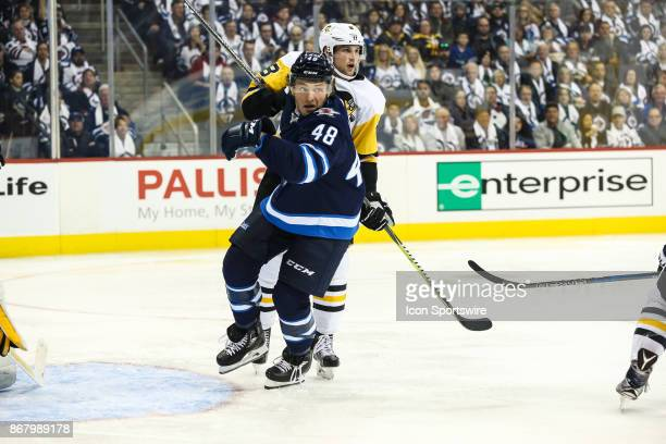 Winnipeg Jets forward Brendan Lemieux eyes the puck during the NHL game between the Winnipeg Jets and the Pittsburgh Penguins on October 29 2017 at...