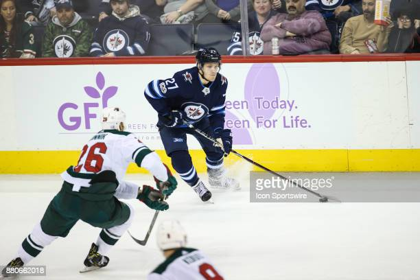 Winnipeg Jets forward Nikolaj Ehlers looks to make a pass during the NHL game between the Winnipeg Jets and the Minnesota Wild on November 27 2017 at...