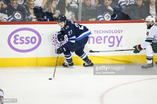 Winnipeg Jets forward Nikolaj Ehlers skates with the puck during the NHL game between the Winnipeg Jets and the Minnesota Wild on November 27 2017 at...