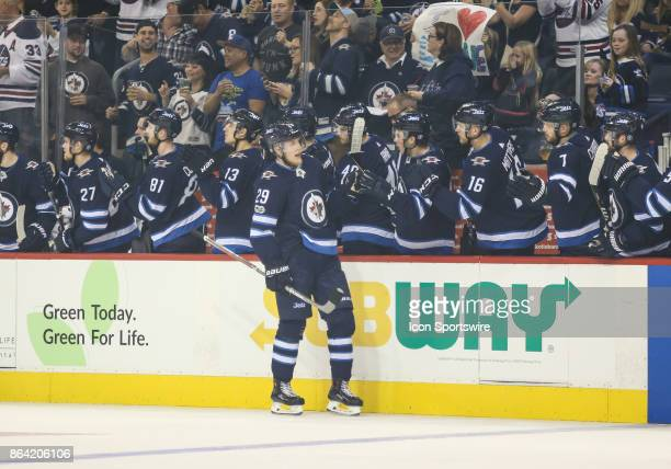 Winnipeg Jets forward Patrik Laine is congratulated by his teammates during the NHL game between the Winnipeg Jets and the Minnesota Wild on October...