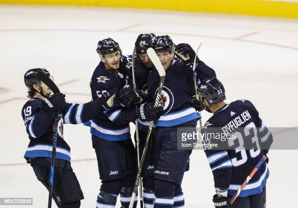 Winnipeg Jets forward Patrik Laine is congratulated on his goal during the NHL game between the Winnipeg Jets and the Minnesota Wild on October 20...