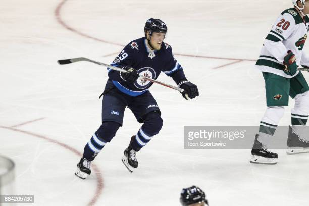 Winnipeg Jets forward Patrik Laine looks for the puck during the NHL game between the Winnipeg Jets and the Minnesota Wild on October 20 2017 at the...