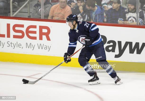 Winnipeg Jets forward Patrik Laine looks to make a pass during the NHL game between the Winnipeg Jets and the Minnesota Wild on October 20 2017 at...