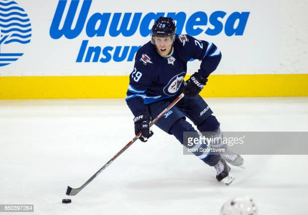 Winnipeg Jets forward Patrik Laine skates with the puck during the NHL game between the Winnipeg Jets and the Edmonton Oilers on September 20 2017 at...