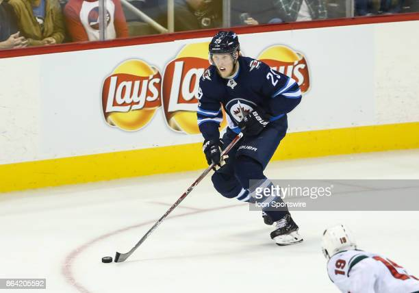 Winnipeg Jets forward Patrik Laine skates with the puck during the NHL game between the Winnipeg Jets and the Minnesota Wild on October 20 2017 at...