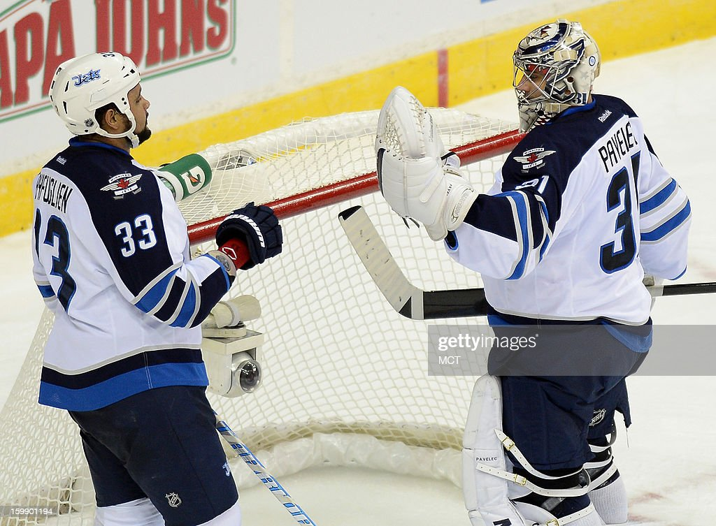Winnipeg Jets goalie Ondrej Pavelec (31) is congratulated by Jets defenseman Dustin Byfuglien (33) following a 4-2 victory over the Washington Capitals at the Verizon Center in Washington, D.C., Tuesday, January 22, 2013.