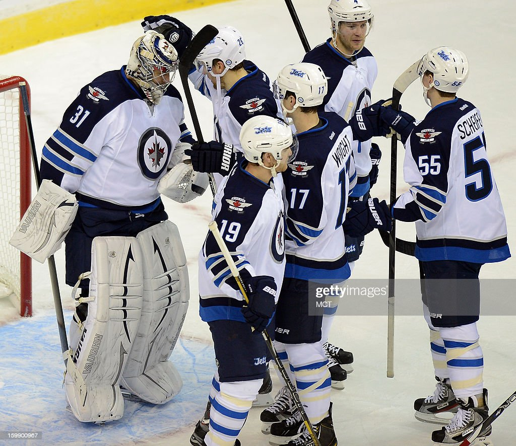 Winnipeg Jets goalie Ondrej Pavelec (31) is congratulated by teammates following a 4-2 victory over the Washington Capitals at the Verizon Center in Washington, D.C., Tuesday, January 22, 2013.