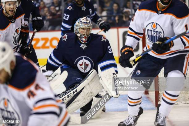 Winnipeg Jets goalie Steve Mason looks for the puck during the NHL game between the Winnipeg Jets and the Edmonton Oilers on September 20 2017 at the...