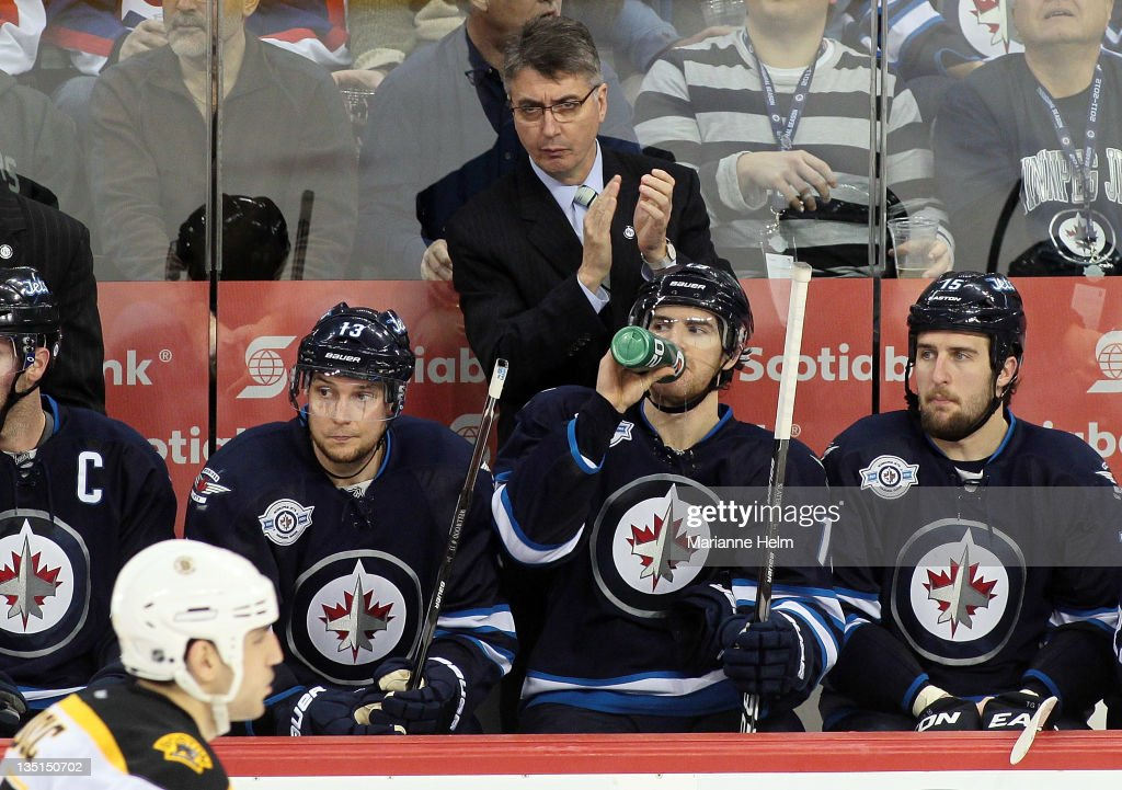 Winnipeg Jets head coach Claude Noel claps to his team on the bench in a game against the Boston Bruins in NHL action at the MTS Centre on December 6, 2011 in Winnipeg, Manitoba, Canada.