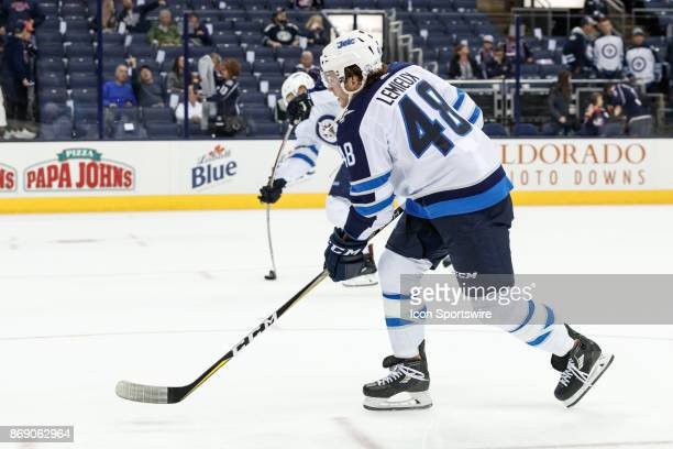 Winnipeg Jets left wing Brendan Lemieux takes a practice shot during warmups before a game between the Columbus Blue Jackets and the Winnipeg Jets on...