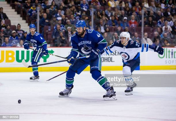Winnipeg Jets Left Wing Nikolaj Ehlers attempts to check Vancouver Canucks Defenceman Erik Gudbranson in a NHL hockey game on October 12 at Rogers...