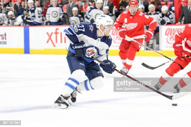 Winnipeg Jets left wing Nikolaj Ehlers skates over the blue line with the puck during the Detroit Red Wings game versus the Winnipeg Jets on December...