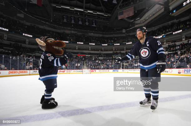 Winnipeg Jets Mascot Mick E Moose celebrates with Blake Wheeler following a 61 victory over the Colorado Avalanche at the MTS Centre on March 4 2017...