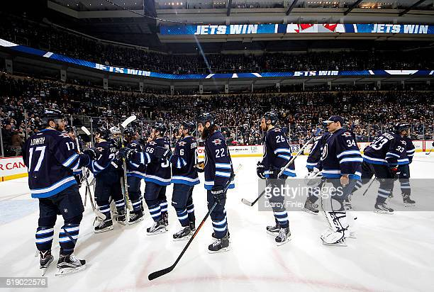 Winnipeg Jets players celebrate a 51 victory over the Minnesota Wild in the final regular season home game at the MTS Centre on April 3 2016 in...