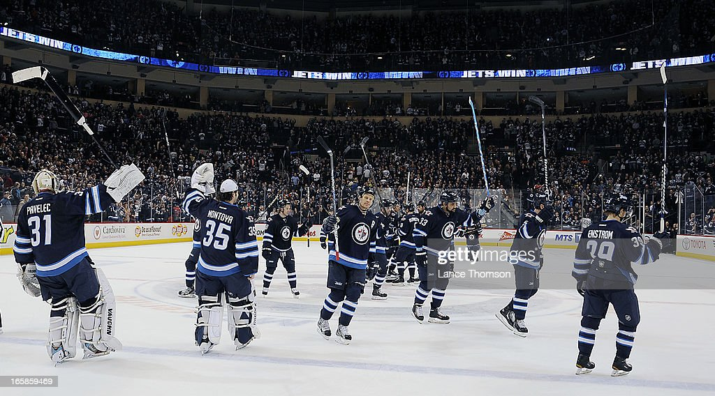 Winnipeg Jets players gather at centre ice to salute their home fans following a 4-1 victory over the Philadelphia Flyers at the MTS Centre on April 6, 2013 in Winnipeg, Manitoba, Canada.