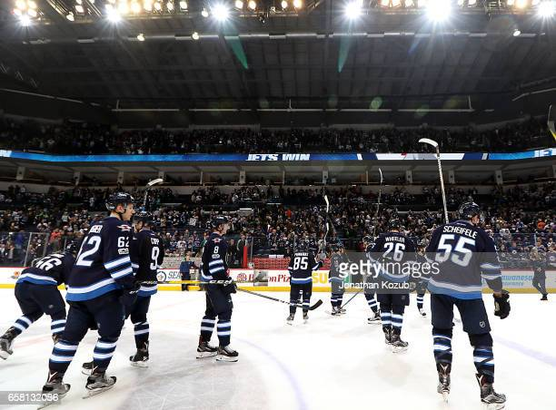 Winnipeg Jets players salute the fans following a 21 victory over the Vancouver Canucks at the MTS Centre on March 26 2017 in Winnipeg Manitoba Canada
