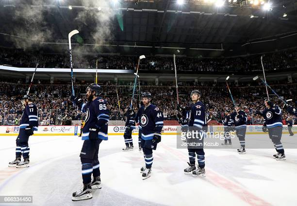 Winnipeg Jets players salute the fans following a 21 victory over the Nashville Predators to end their regular season at the MTS Centre on April 8...